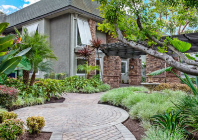Beachwood Apartments garden with green plants and walkways