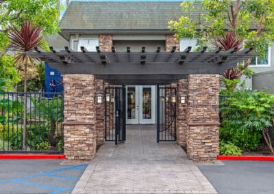 Beachwood Apartments gated entrance with green plants