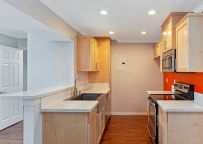 Kitchen with quartz countertops, cabinets, and stainless steel appliances